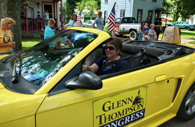 Penny Thompson drives the GT Thompson campaign car in a Warren, PA parade.